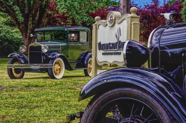 Vintage Ford cars parked around the Worthington Park sign. Photo Copyright ©2019 Jeff Childs, published with permission.