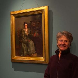 Christine Satterlee poses next to Harriet Foster Beecher's Pondering, on display in the Worthington Mansion.